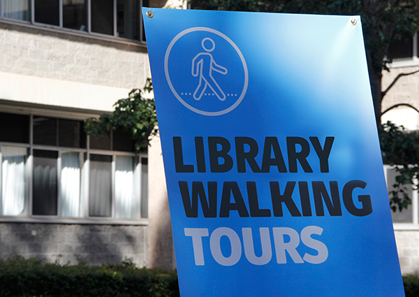 A sign that says library walking tours